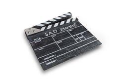 Clapperbräde på ledsen film för vit bakgrundstitel Arkivfoto