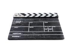 Clapperbräde på vit bakgrund Arkivfoton