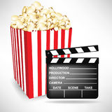 Clapping board and popcorn bucket Stock Photography