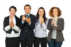 Clapping business people in a row. Clapping happy business people standing in a row isolated on white background stock photo