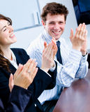 Clapping businesspeople. Happy businesspeople clapping on business training at office, smiling royalty free stock photo