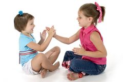 Clapping Games. Two sisters, 4 and 6, playing clapping games Royalty Free Stock Image