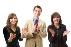 Clapping. Group of smiling businesspeople. Isolated Royalty Free Stock Photo