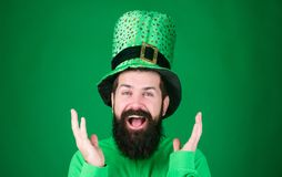 Clapping his hands with joy. Happy saint patricks day. Happy hipster in leprechaun hat and costume. Bearded man. Celebrating saint patricks day. Irish man with royalty free stock images