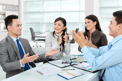 Clapping office workers Stock Photography