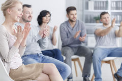 Clapping at support group meeting. Happy people clapping at support group meeting stock images