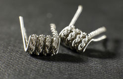 Clapton staged staggered helix coil build for vaping rebuildable atomizer.  royalty free stock photography
