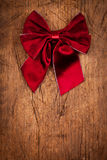 Claret bow on wooden table, Christmas decoration Royalty Free Stock Photography