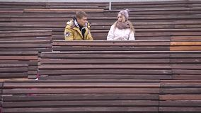 Clarification of relationship on the bench. Man and woman are arguing on the bench stock footage