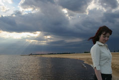 Clarified. The girl on a background of clouds and seacoast Royalty Free Stock Photos