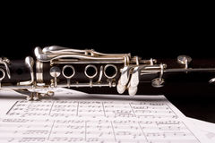 Clarinet. Photograph of a clarinet isolated over sheet music Royalty Free Stock Image