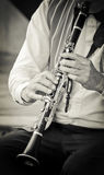 Clarinet. Vintage clarinet musician playing his instrument in a jazz band royalty free stock photography