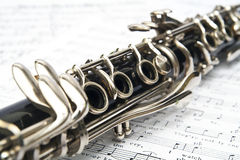 Clarinet. Close-up of clarinet on music sheet with the white background Stock Images