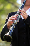 Clarinet. A woman in black playing clarinet Royalty Free Stock Photography