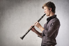 Clarinet. Young man playing the clarinet Royalty Free Stock Image