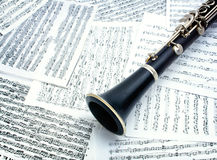 Clarinet. Musical instrument surrounded by scores Royalty Free Stock Photo