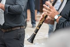 clarinet band musician walking in the street Stock Photos