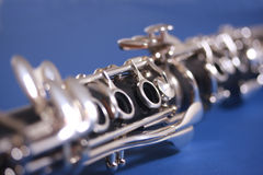 Clarinet on blue. Close up of clarinet on blue background Royalty Free Stock Photos