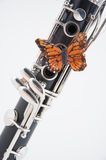 Clarinet with Butterfly on White Royalty Free Stock Photography