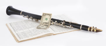 Clarinet and dollar Stock Image