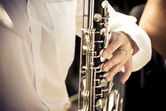 Clarinet e mano Fotografia Stock