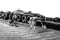 Clarinet en música de hoja Fotografía de archivo