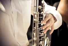 Clarinet and hand Stock Photo