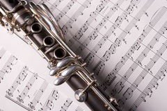 Clarinet isolated over sheet music Stock Photography