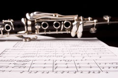 Clarinet isolated over sheet music Stock Images