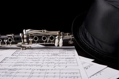 Clarinet isolated over sheet music Royalty Free Stock Photos