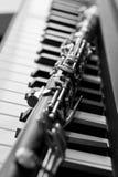 Clarinet lying on piano keys Royalty Free Stock Photos