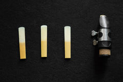 Clarinet mouthpiece and Reed. The clarinet mouthpiece on black background stock photography
