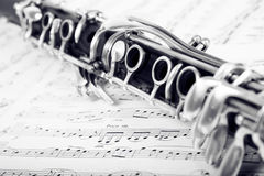 Clarinet on music. Clarinet arranged across a swheet of music close up view Stock Image