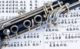 Clarinet and Music. Stock Images