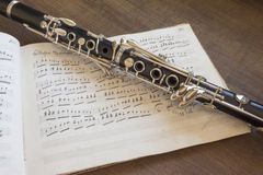 Clarinet and musical score. On the table Stock Photography