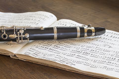 Clarinet and musical score. On the table Royalty Free Stock Images