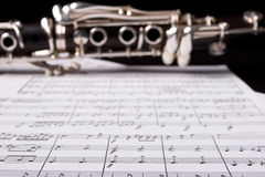 Clarinet over sheet music Royalty Free Stock Photos