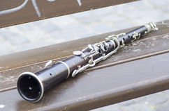Clarinet on a park bench Stock Photo