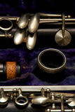 Clarinet parts detail. Parts of a clarinet are stored in blue lined case Royalty Free Stock Images