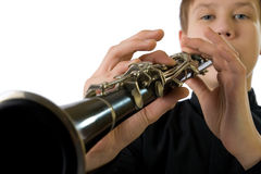 Clarinet player. It is isolated on a white background royalty free stock images