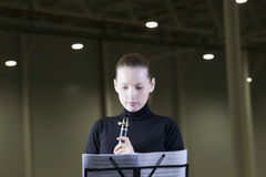 Clarinet Player Looking At Music Sheet Royalty Free Stock Image