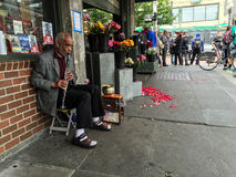 Clarinet player 2 outside a flower shop near Pike Place Market, Seattle Stock Photos