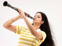 Clarinet que sopla femenino Imagen de archivo libre de regalías