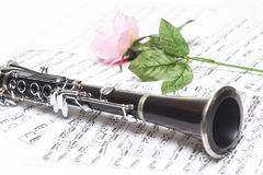 Clarinet with sheet music. Clarinet with red rose on sheet music royalty free stock images