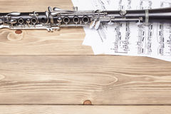 Clarinet with sheet music. On wood beckground Stock Image