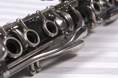Clarinet on white staves Stock Photography