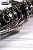 Clarinet on white staves Stock Image