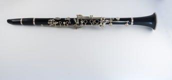 Clarinete en el fondo blanco Imagen de archivo libre de regalías