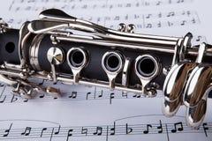 Clarinete y nota musical Foto de archivo