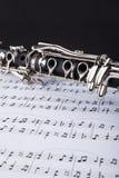 Clarinete y nota musical Fotos de archivo libres de regalías